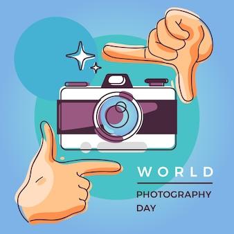 Día mundial de la fotografía con cámara y manos.