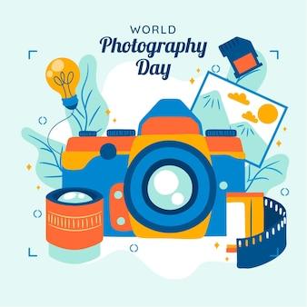 Día mundial de la fotografía con cámara y película.