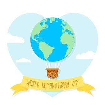 Día mundial humanitario con globo aerostático como planeta