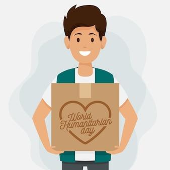 Día mundial humanitario con hombre sujetando la caja