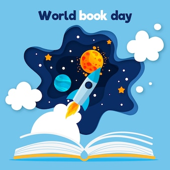 Día mundial del libro con libro abierto y cohete