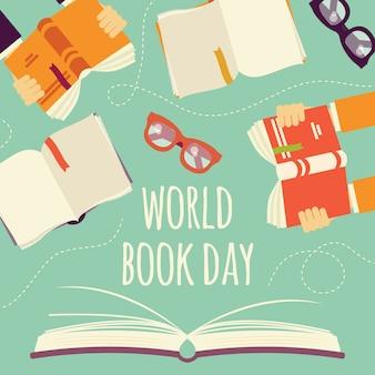 Día mundial del libro, libro abierto con las manos sosteniendo libros y gafas.