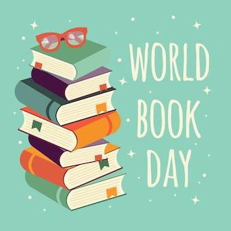 Día mundial del libro, pila de libros con gafas sobre fondo de menta