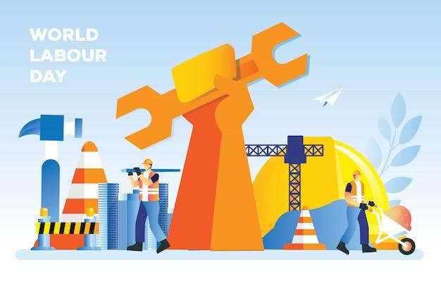 Día mundial del trabajo con una mano de obra trae un casco de llave de mano grande de madera y arena