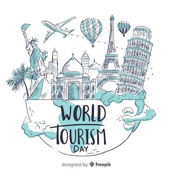 Día mundial del turismo dibujado a mano con monumentos famosos
