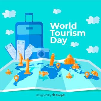 Día mundial del turismo plano con equipaje y mapa