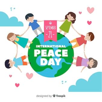 Día de paz con niños tomados de la mano y corazones
