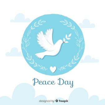 Día de la paz plana con paloma y hojas de olivo