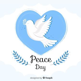 Día plano de la paz en una burbuja de corazón