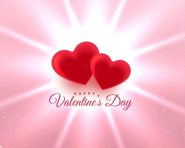 Día de san valentín dos corazones rojos fondo brillante