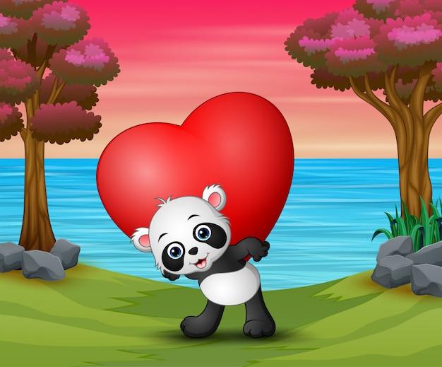 Día de san valentín con un panda mantenga corazón rojo