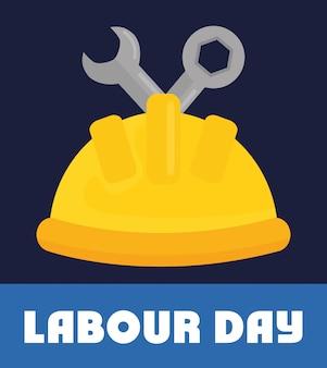 Día del trabajo. casco constructor con llaves de llave.