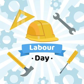 Día del trabajo con casco y herramientas.