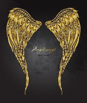 Dibujado a mano adornado alas de ángel de oro en estilo zentangle