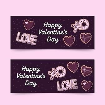 Dibujado a mano banner y corazones de san valentín