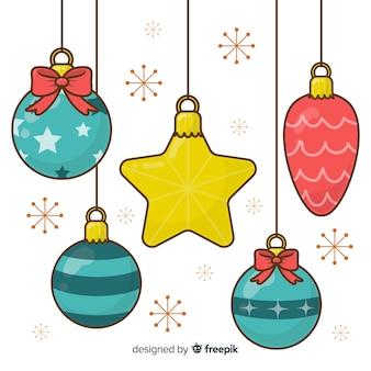 Dibujado a mano bolas de navidad y estrellas