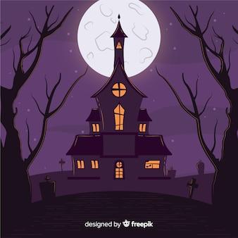 Dibujado a mano casa embrujada de halloween con luna llena