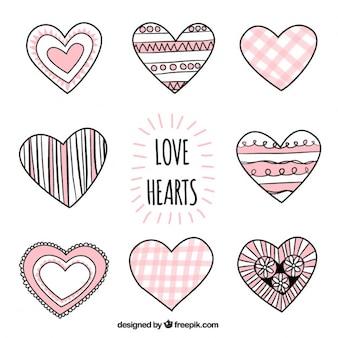 Dibujado a mano corazones de amor