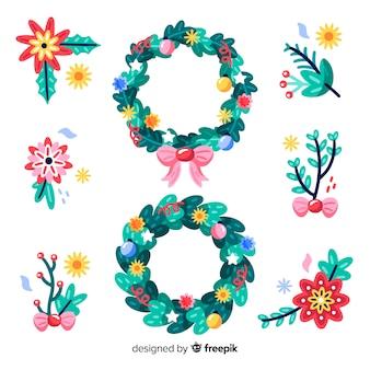Dibujado a mano coronas florales de navidad y flores