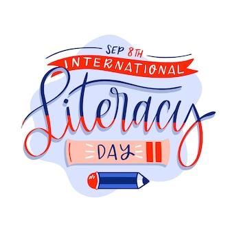 Dibujado a mano el día internacional de la alfabetización con lápiz