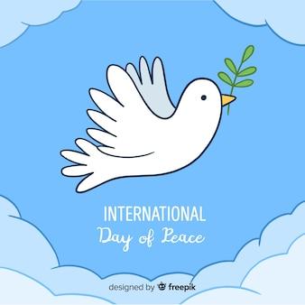 Dibujado a mano el día de la paz con una paloma
