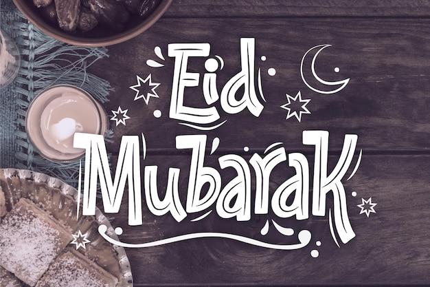 Dibujado a mano eid al-fitr - letras eid mubarak