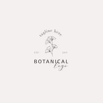 Dibujado a mano elegante logo floral de ginkgo biloba con tageline