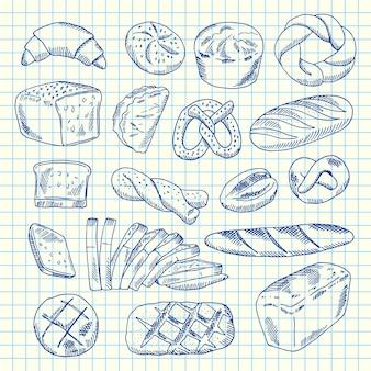 Dibujado a mano elementos de panadería contorneados en hoja de papel