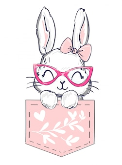 Dibujado a mano feliz conejo está sentado en un bolsillo rosa.
