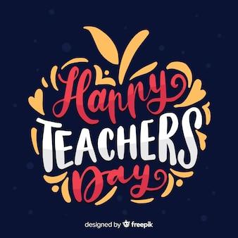 Dibujado a mano letras del día del maestro del mundo en forma de manzana