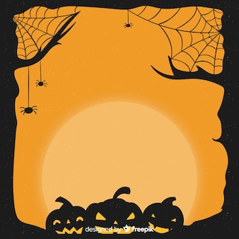 Dibujado a mano marco de halloween con calabazas