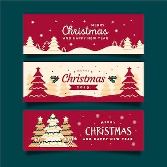 Dibujado a mano pancartas de navidad con árbol de navidad y fondo rojo