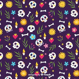 Dibujado a mano patrón de cráneos rotados día de muertos