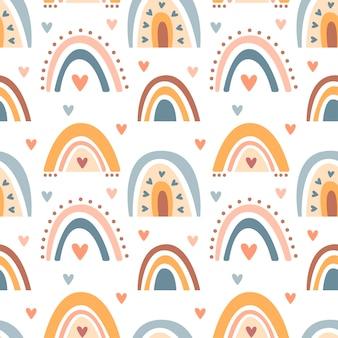 Dibujado a mano de patrones sin fisuras de color pastel lindo arco iris boho aislado sobre fondo blanco. vector ilustración plana. diseño para textiles para bebés, papel tapiz, envoltura, telón de fondo.