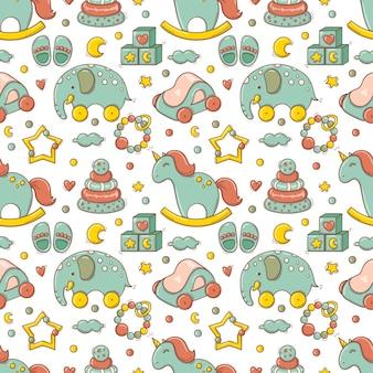 Dibujado a mano de patrones sin fisuras con juguetes y accesorios coloridos para bebés