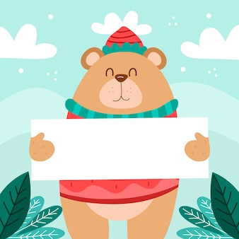 Dibujado a mano personaje de navidad oso sosteniendo pancarta en blanco