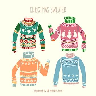 Dibujados a mano jerséis de navidad de colores