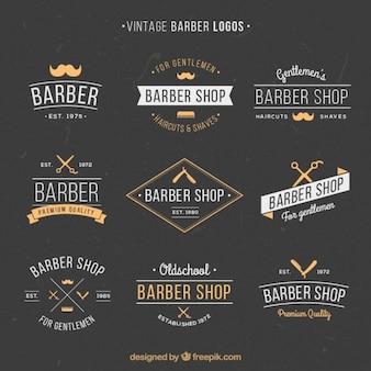 Dibujados a mano logotipos barber vintage