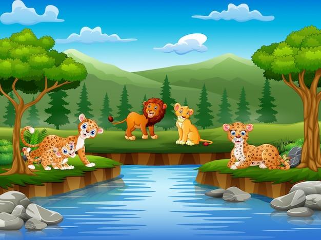 Los dibujos animados de animales están disfrutando de la naturaleza junto al río.