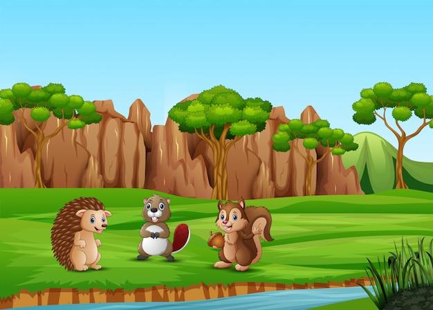 Dibujos animados de animales felices en el campo