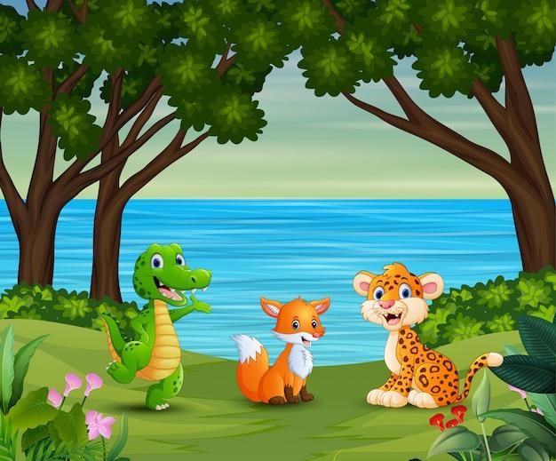Dibujos animados de animales felices están disfrutando en la hermosa naturaleza