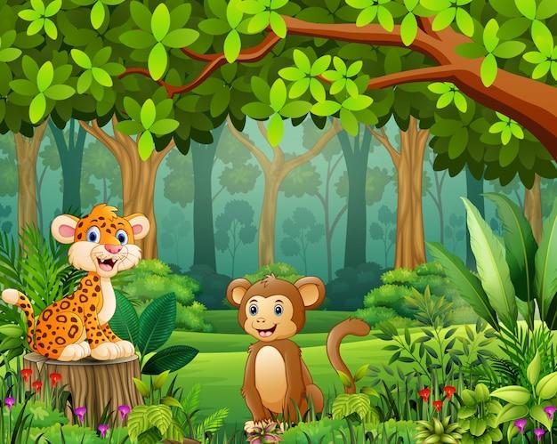 Dibujos animados de animales en el hermoso paisaje de bosque verde