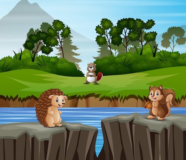Dibujos animados de animales jugando en el fondo de la naturaleza