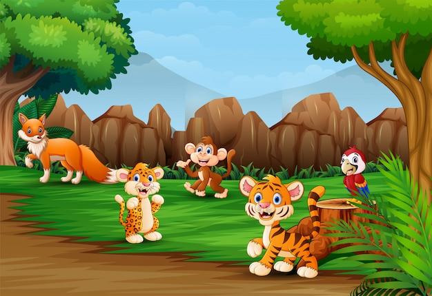 Dibujos animados de animales salvajes en el hermoso paisaje de la naturaleza