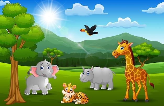 Dibujos animados de animales salvajes en la selva con un fondo de montaña