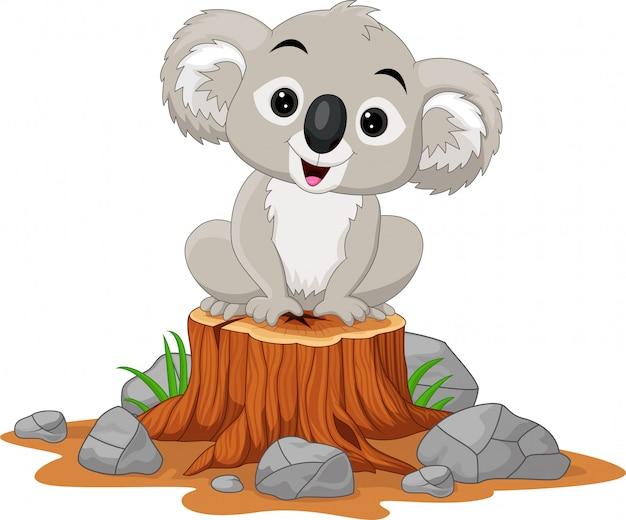 Dibujos animados bebé koala sentado en tocón de árbol
