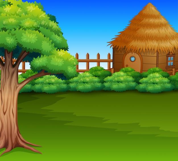 Dibujos animados de la cabaña de madera en un campo verde