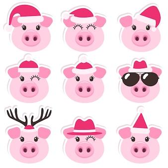 Dibujos animados de cerdos lindos con gorros de navidad santa