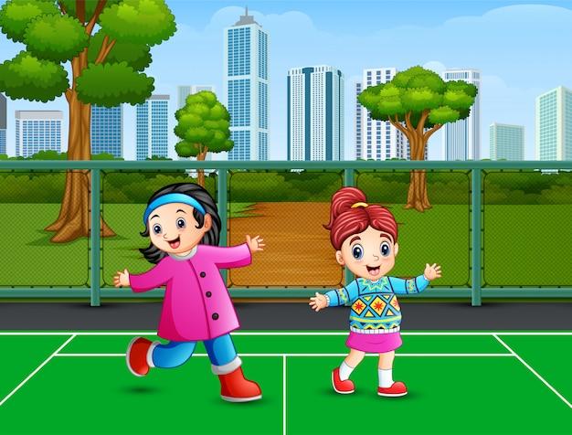 Dibujos animados de dos chicas bailando en la cancha