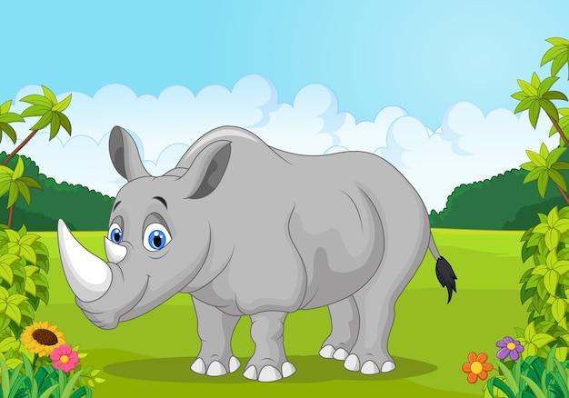 Dibujos animados feliz rinoceronte en la selva